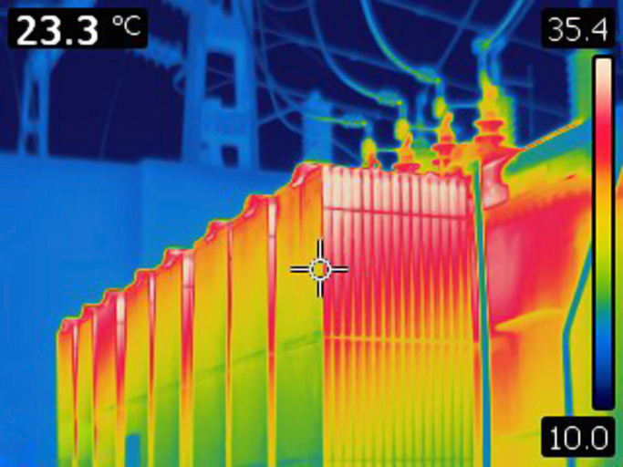 Thermal image of electrical transformer. Colors represent various temperatures, defined with rainbow Celsius scale on right side of image. Temperature on upper left corner is a temperature of a point where cursor is. Photo is taken with Flir T420 infrared camera.
